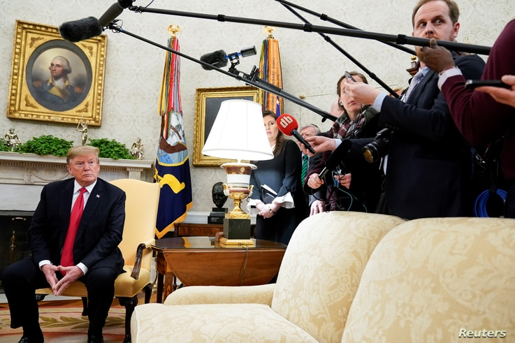 U.S. President Donald Trump listens to a reporter's question while meeting with NATO Secretary General Jens Stoltenberg in the Oval Office at the White House in Washington, April 2, 2019.