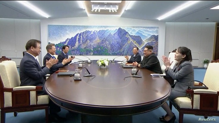 South Korean President Moon Jae-in and North Korean leader Kim Jong Un attend the inter-Korean summit at the truce village of Panmunjom, in this still frame taken from video, South Korea April 27, 2018.