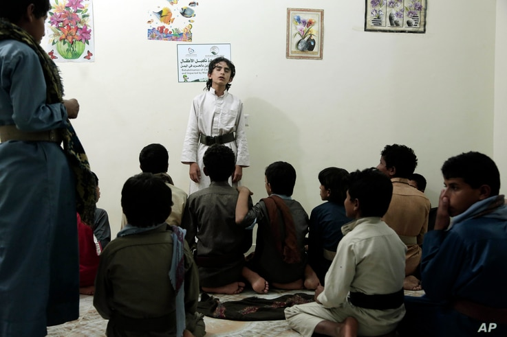 Boys recite poems during a session at a rehabilitation center for former child soldiers in Marib, Yemen, in this July 25, 2018 photo.