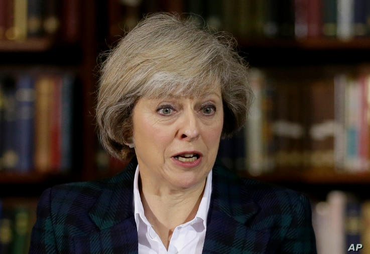 FILE - Britain's Home Secretary Theresa May launches her leadership bid for Britain's ruling Conservative Party in London, June 30, 2016.