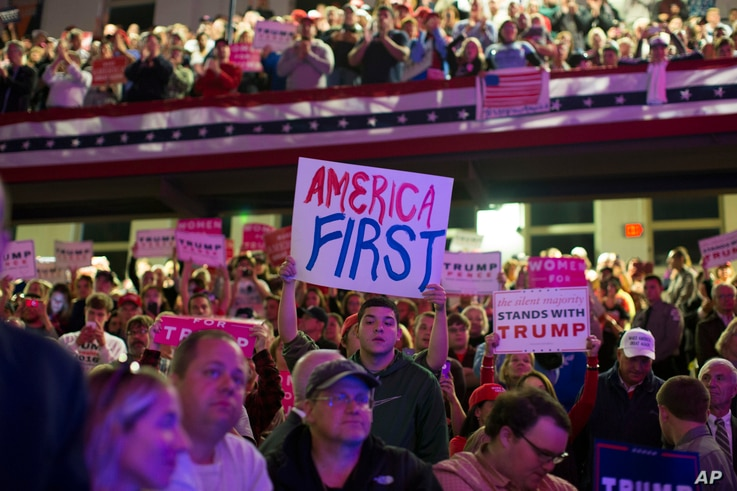 Supporters of Republican presidential candidate Donald Trump listen to him speak during a campaign rally at Lackawanna College in Scranton, Pennsylvania, Nov. 7, 2016.