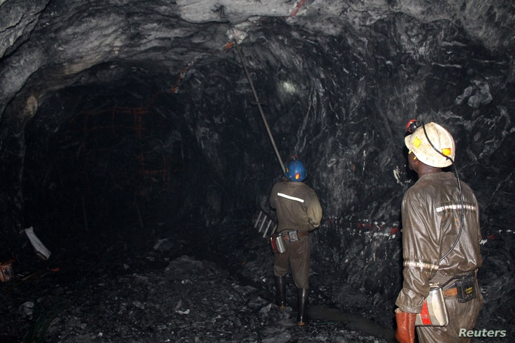 FILE - Workers are pictured at a mine in Bindura town, Zambia, Feb. 7, 2015.