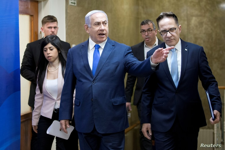 Israeli Prime Minister Benjamin Netanyahu, center, arrives to attend the weekly cabinet meeting in Jerusalem, March 17, 2019.