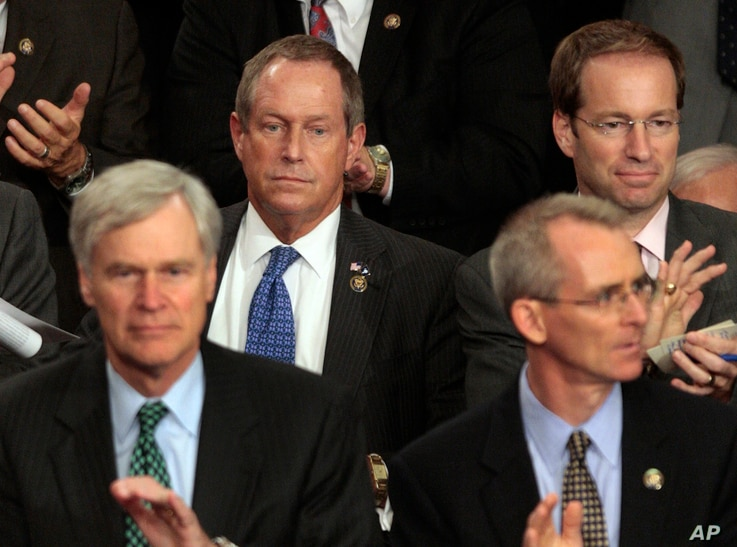 """FILE - Rep. Joe Wilson, R-S.C., center, listens during President Barack Obama's speech on health care to a joint session of Congress on Capitol Hill in Washington, Sept. 9, 2009. During the address, Wilson shouted, """"You lie!"""""""