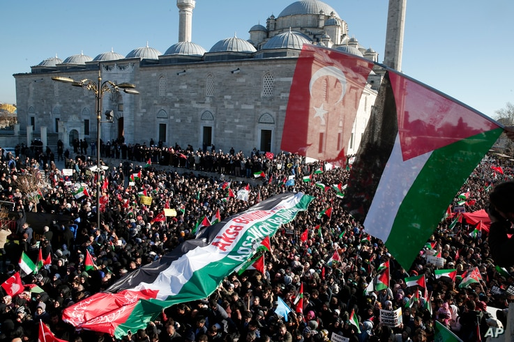 Thousands of protesters, some holding Palestinian and Turkish flags march in the streets after Friday prayers in Istanbul, Dec. 8, 2017, against U S. President Donald Trump's decision to recognize Jerusalem at the capital of Israel.