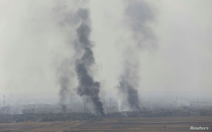 Smoke rises from clashes at Bartila in the east of Mosul during clashes with Islamic State militants, Iraq, Oct. 18, 2016.