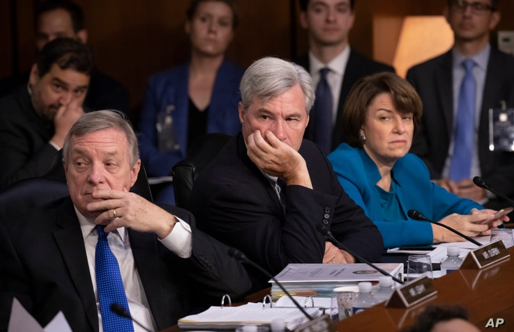Democrats on the Senate Judiciary Committee, from left, Sen. Dick Durbin, D-Ill., Sen. Sheldon Whitehouse, D-R.I., and Sen. Amy Klobuchar, D-Minn., and other minority members, appeal to Chairman Chuck Grassley, R-Iowa, to delay the confirmation heari...