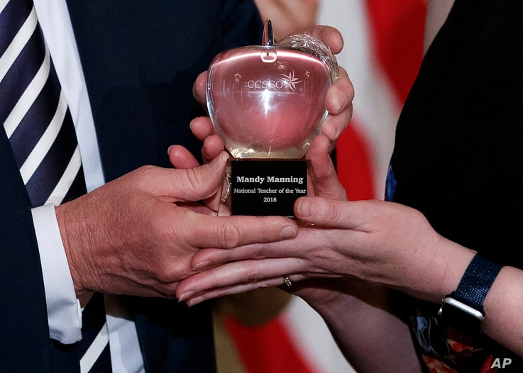 The National Teacher of the Year award, presented to Mandy Manning, a teacher at the Newcomer Center at Joel E. Ferris High School in Spokane, Wash., in the East Room of the White House in Washington, May 2, 2018.