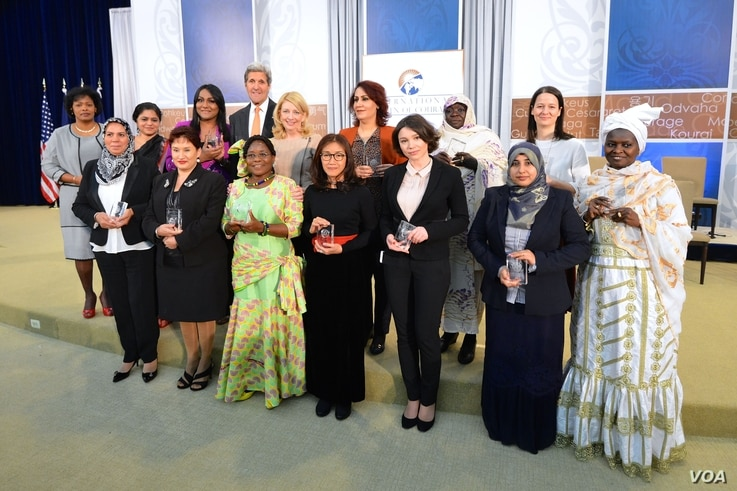 U.S. Secretary of State John Kerry and U.S. Ambassador-at-Large for Global Women's Issues Cathy Russell pose for a photo with the 2016 Secretary of State's International Women of Courage Award winners at the U.S. Department of State in Washington, D.