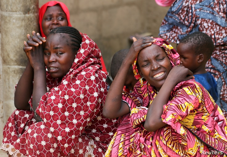 Relatives of missing school girls react in Dapchi in the northeastern state of Yobe, after an attack on the village by Boko Haram, Nigeria, Feb. 23, 2018.
