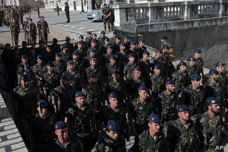 Soldiers rehearse outside the Royal Palace on June 18, a day before 46-year-old Prince Felipe will be proclaimed king in Madrid, Spain, on June 19.