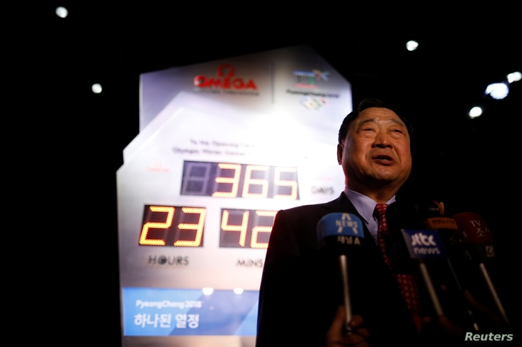 Lee Hee-beom, head of the Pyeongchang Organizing Committee for the 2018 Olympic and Paralympic Winter Games, speaks in front of the Olympic countdown clock after its unveiling ceremony in Seoul, South Korea, Feb. 8, 2017.