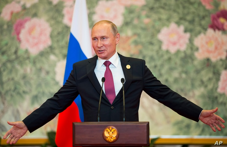 Russian President Vladimir Putin speaks during a news conference after the Shanghai Cooperation Organization (SCO) Summit in Qingdao in eastern China's Shandong Province, June 10, 2018.