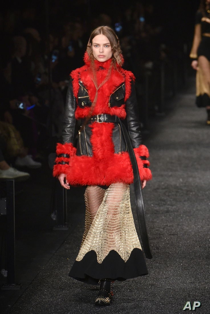 A model wears a creation for Alexander McQueen's Fall-Winter 2017-18 ready to wear fashion collection presented March 6, 2017, in Paris.