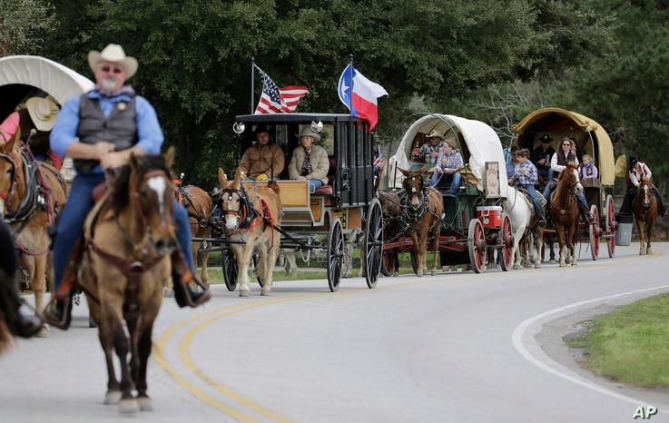 Sam Houston Trail Riders ride toward Spring Creek Park in Tomball, Texas, Feb. 23, 2016. More than 3,000 riders from 13 trail rides converged a few days later in Houston as part of the Houston Livestock Show and Rodeo.