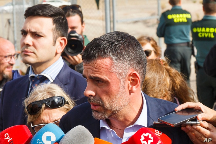 Santi Vila, Catalonia's regional chief for business, talks to journalists as he leaves the Estremera prison in Madrid, Nov. 3, 2017.
