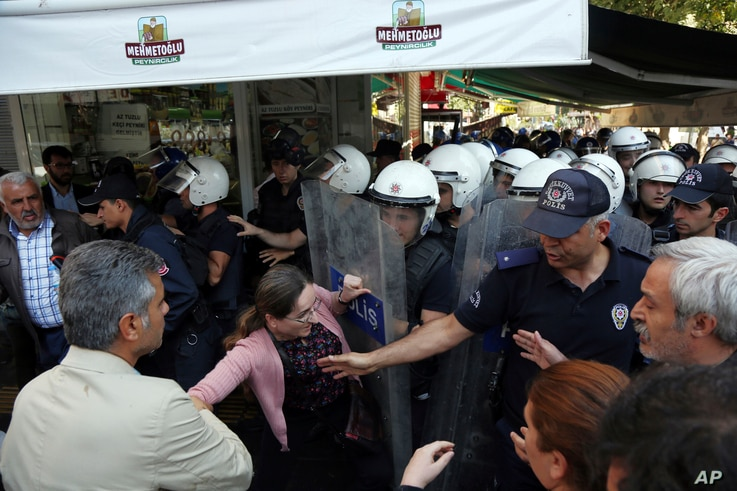 Police officers detain a pro-Kurdish Peoples' Democratic Party member as they protest the detention of Gultan Kisanak, Diyarbakir mayor, and Co-mayor Firat Anli, in Diyarbakir, Turkey, Oct. 26, 2016.