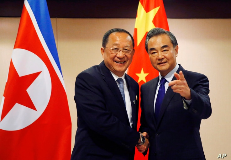 N. Korean Foreign Minister Ri Yong Ho, left, is greeted by his Chinese counterpart Wang Yi prior to their bilateral meeting on the sidelines of the 50th ASEAN Foreign Ministers' Meeting and its Dialogue Partners, Aug. 6, 2017 in suburban Pasay city, ...