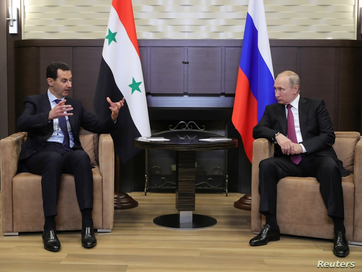 Russian President Vladimir Putin meets with Syrian President Bashar al-Assad in the Black Sea resort of Sochi, Russia, May 17, 2018.