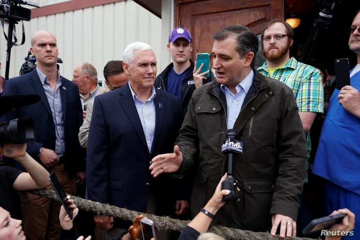US Republican presidential candidate Ted Cruz (R-TX) is joined by governor Mike Pence (R-IN) at a campaign event at The Mill in Marion, Indiana, May 2, 2016.
