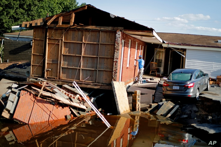 Part of the Starlite Motel is washed away in the aftermath of flooding from Hurricane Florence in Spring Lake, North Carolina, Sept. 19, 2018.