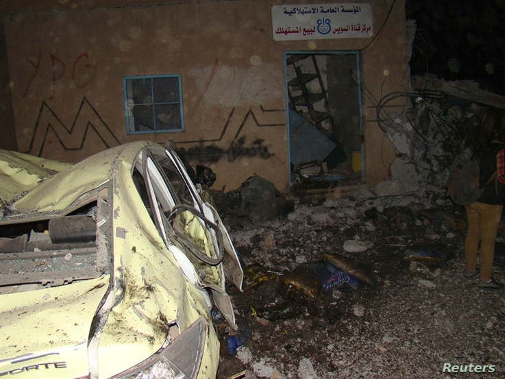A view of the damage from a suicide bombing at the Kurdish Internal Security Forces Center (Asayish) at the Suez Canal neighborhood in Qamishli, Syria, Nov. 23, 2013.