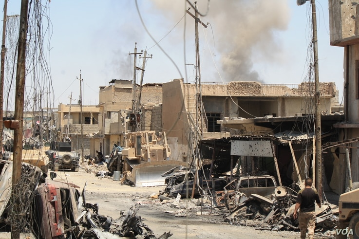 After Iraqi forces force IS out of an area, homes and cars are often destroyed and IS mortars continue to fall in Mosul, June 4, 2017.