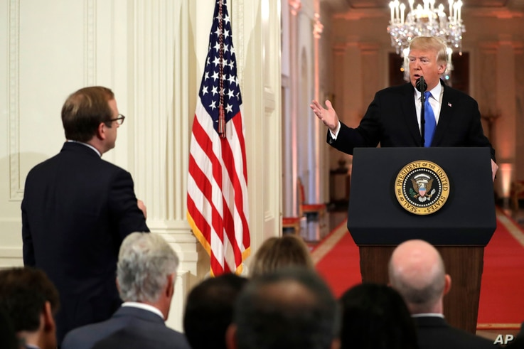 President Donald Trump takes questions as he speaks during a news conference in the East Room of the White House, Nov. 7, 2018, in Washington.