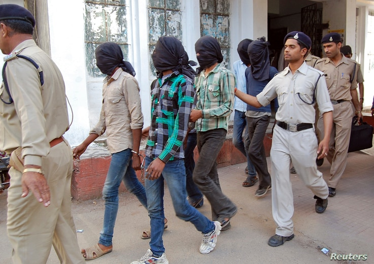 Police escort men accused of a gang rape to a court in Datia district in the central Indian state of Madhya Pradesh, March 18, 2013.