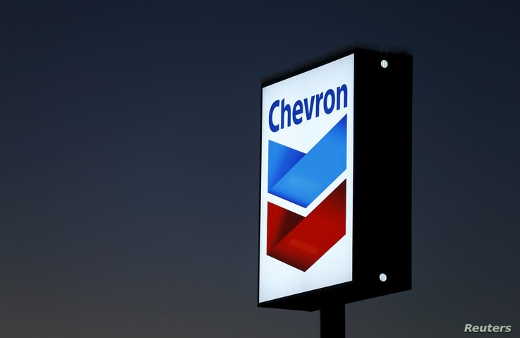 FILE - A Chevron gas station sign is shown in Cardiff, California, Jan. 25, 2016.