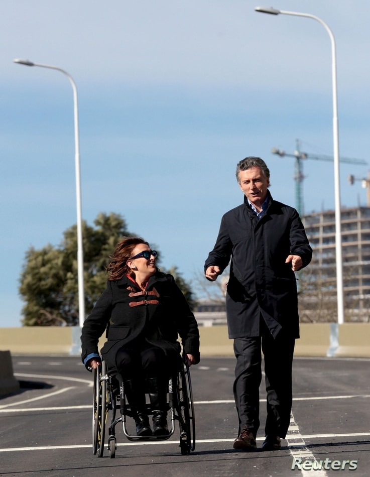 Mauricio Macri (R), Buenos Aires' City Mayor and Argentina's presidential contender walks alongside Senator Gabriela Michetti after he inaugurated a portion of a freeway in Buenos Aires, June 19, 2015.