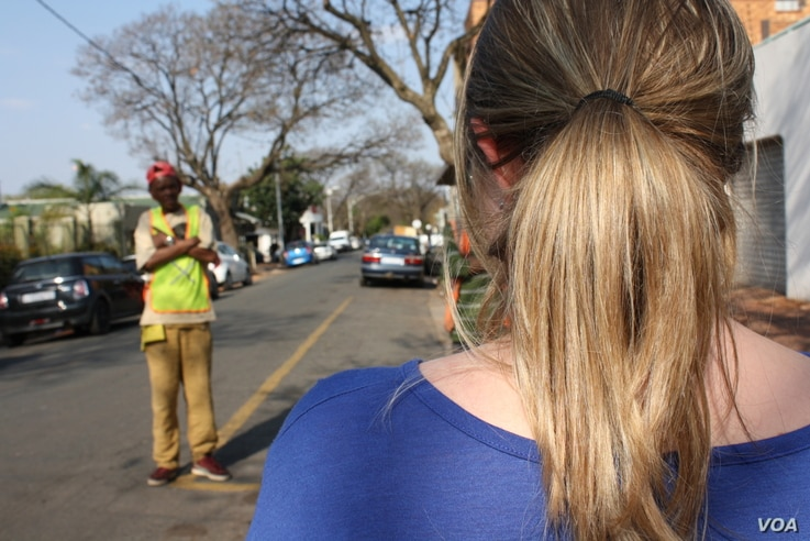 This young woman, who asked to remain anonymous, alleges the Metro Police assaulted her and accused her of driving drunk, at this intersection in Johannesburg, Tuesday, Sept. 11, 2015. (photo: D. Taylor)