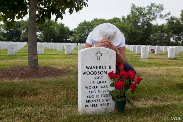 Waverly Woodson is buried at Arlington National Cemetery where American buries its heroes. . Each May around Memorial Day, his widow, Joann, arranges the red roses her husband loved so much beside his grave. (Photo: Linda Hervieux)