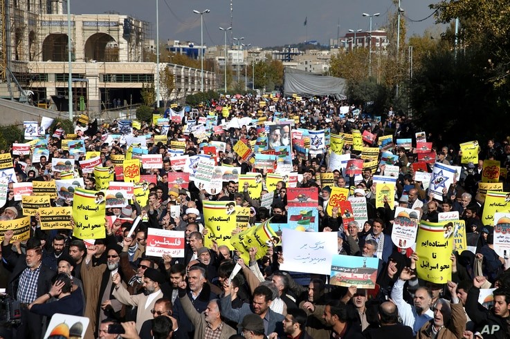 Iranian worshippers chant slogans in a rally after Friday prayer in Tehran, Iran, Dec. 8, 2017. Hundreds staged a rally to show their anger against the U.S. President Donald Trump administration's recognition this week of Jerusalem as the capital of ...