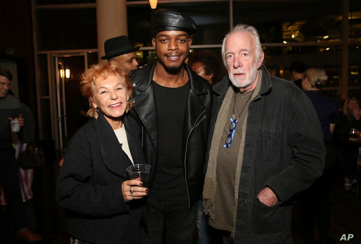 """Caroline Ducrocq, Stephan James and Howard Hesseman seen at the Annapurna Pictures' """"If Beale Street Could Talk"""" screening at ArcLight Hollywood on Tuesday, Oct. 23, 2018, in Los Angeles."""