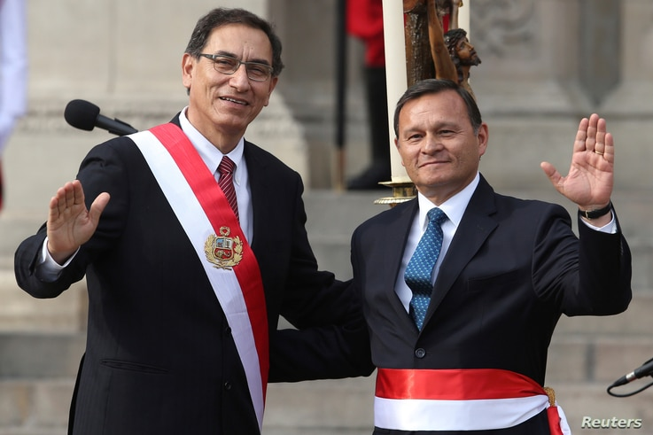 Peru's President Martin Vizcarra, left, and new Foreign Minister Nestor Popolizio pose for a picture during a swearing-in ceremony at the government palace in Lima, April 2, 2018.
