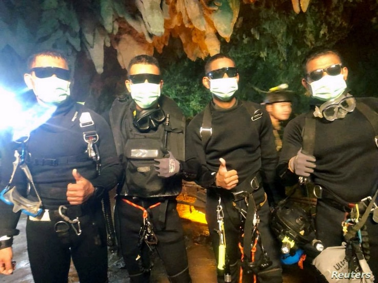 Four Thai Navy Seals are seen after leaving the cave safe during the rescue mission, Chiang Rai Province, Thailand, July 10, 2018 in this photo obtained from social media.
