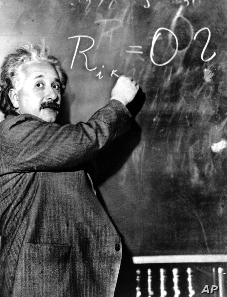 Albert Einstein writes out an equation for the density of the Milky Way on the blackboard at the Carnegie Institute, Mt. Wilson Observatory headquarters in Pasadena, Calif., on Jan. 14, 1931.
