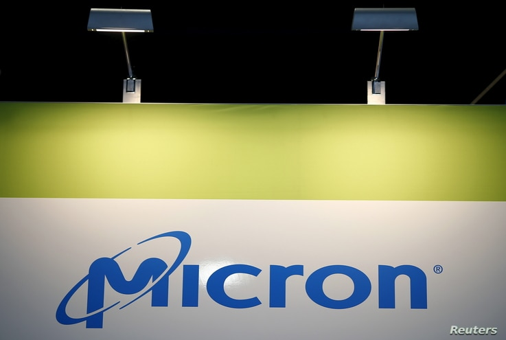 FILE - The logo of U.S. memory chip maker Micron Technology is pictured at its booth at an industrial fair in Frankfurt, Germany,  July 14, 2015.