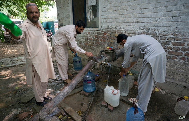 People collect water at a tube well in Islamabad, Pakistan, Aug. 23, 2017. A new study suggests about 50 million Pakistanis could be at risk of drinking arsenic-tainted groundwater. The findings are based on a hazard map built using water quality dat...