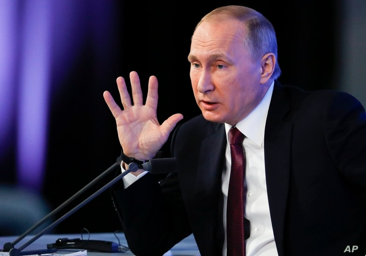 Russian President Vladimir Putin gestures during his annual news conference in Moscow, Russia, Dec. 23, 2016.