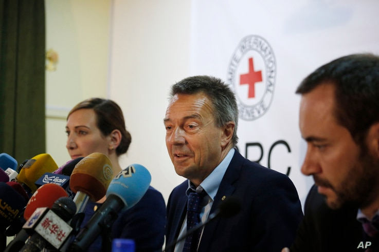 FILE - Peter Maurer, president of the International Committee of the Red Cross, center, speaks to journalists during a press conference in Sanaa, Yemen, Sunday, Aug. 9, 2015.