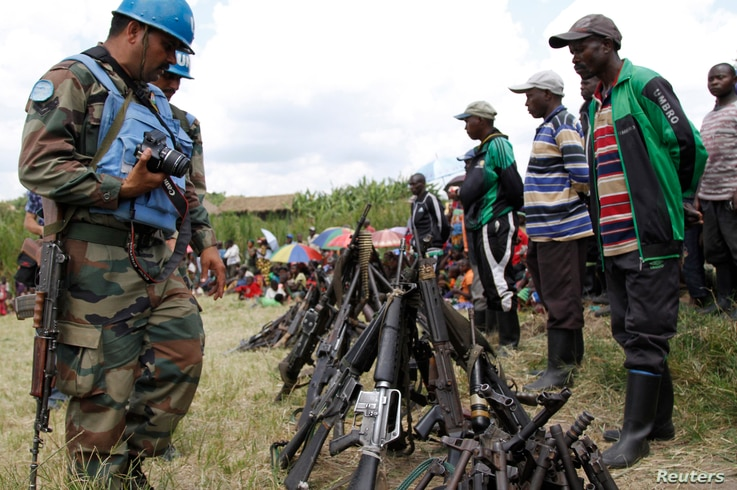 United Nations peace keepers record details of weapons recovered from the Democratic Forces for the Liberation of Rwanda (FDLR) militants after their surrender in Kateku, a small town in eastern region of the Democratic Republic of Congo (DRC), May 3...