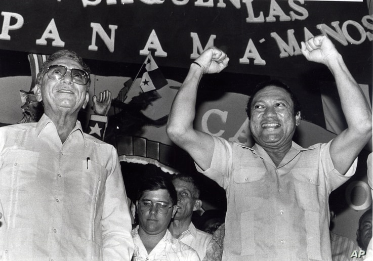 Panama's newly appointed President Manuel Solis Palma stands next to his friend General Manuel Antonio Noriega who appointed him during a rally in 1988.