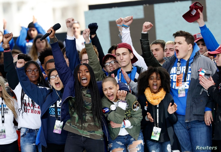 Students celebrate at the end of the March for Our Lives event in Washington, D.C., March 24, 2018.