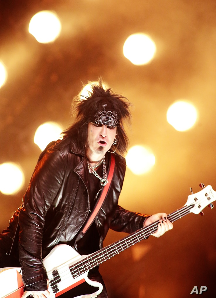 FILE - In this April 28, 2015 file photo, Nikki Sixx of Motley Crue performs in concert with the band Sixx:A.M. at The Electric Factory in Philadelphia.