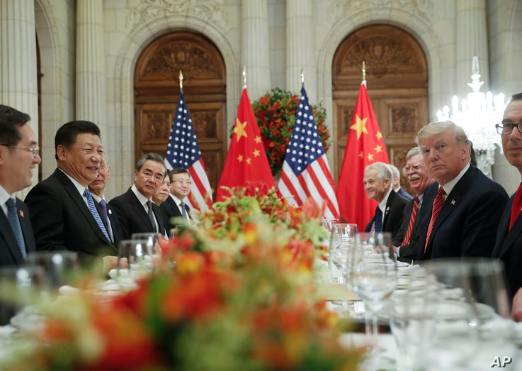 President Donald Trump and China's President Xi Jinping lead their respective delegatiosn during their bilateral meeting at the G-20 Summit, Dec. 1, 2018, in Buenos Aires, Argentina.