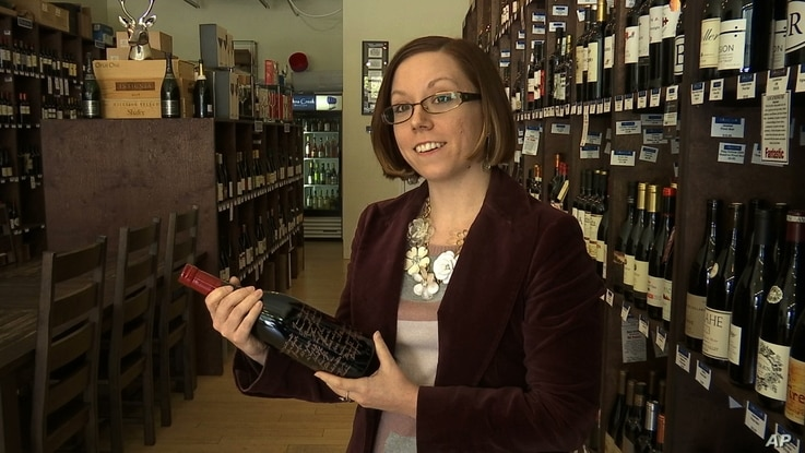Amelia Beesley, 31, general manager of a boutique fine wine shop in Johns Creek, Ga., is photographed March 24, 2017. The Democrat from suburban Atlanta says the showdown on Capitol Hill over the American Health Care Act shows President Donald Trump ...