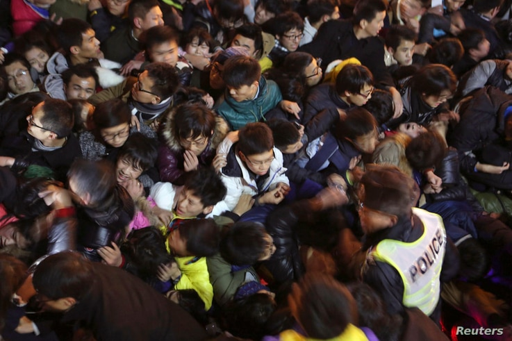 A view of a stampede is seen during the New Year's celebration on the Bund, a waterfront area in central Shanghai, Dec. 31, 2014.