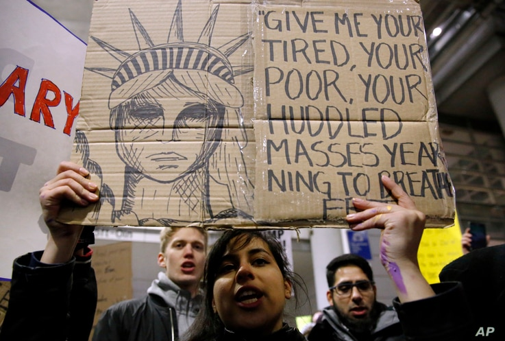 Demonstrators converge outside Terminal 5 of O'Hare International Airport, Jan. 29, 2017, in Chicago, as people protest President Donald Trump's executive order banning travel to the United States by citizens of several countries.